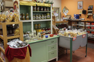 An image of a store with chips, bagged items and canned items.