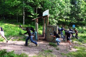An image of a group of people playing paint ball.