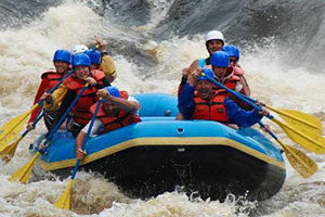 An image of a group of white water rafting.