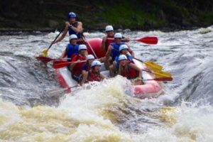 An image of a group of people going down the rapids in a raft.