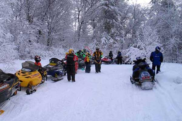 An image of snow mobilers taking a break.