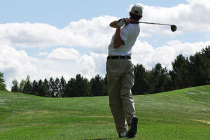 An image of a golfer at the end of his swing.