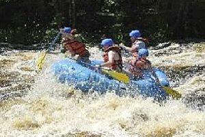 An image of water splashing a group in a raft.