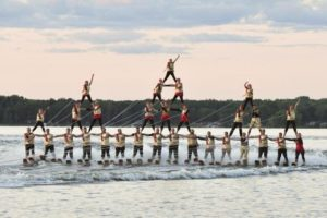 An image of synchronized skiiers performing a pyramid.