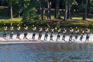 An image of a line of synchronized skiiers.