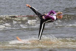 An image of a woman doing a swivel on a waterski.